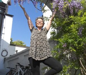 Tree pose amongst wisteria